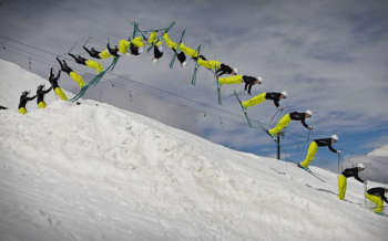 While moving in the horizontal plane the skier approaches the jump. The takeoff is initiated both upwards and backwards which starts a primary rotation in the horizontal axis. The upper and lower body then extend. There is a flexion at the waist between the upper body and lower body to the tuck position. The body rotations backwards a total of 360 degrees, then the skiers extends and prepares for the landing.